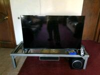 black flat screen TV with remote 279 mi