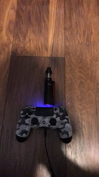 Black sony ps4 game controller Bedford, B4A 3T6