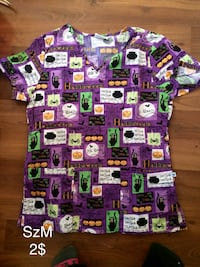 purple and green Halloween themed scrub suit top