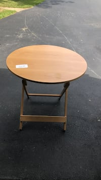 Round brown wooden folding table