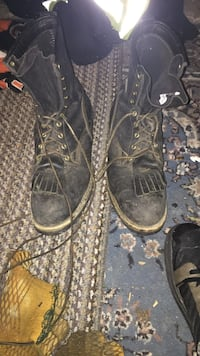 Pair of black leather boots on use 3 or 4 times