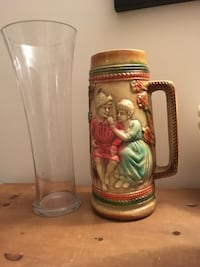 Clear glass vase and brown ceramic beer stein Saint-Lazare