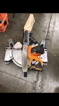 RIDGID 15 Amp Corded 12 in. Dual Bevel Miter Saw with Adjustable Laser Guide, Carbide Tipped Blade, and Dust Bag 2259 mi