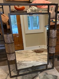 Large mirror with lights on both sides.
