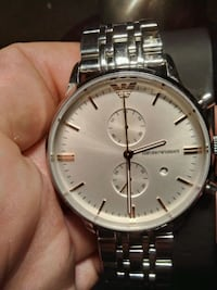 round silver-colored chronograph watch with link b Calgary, T3L 1J9