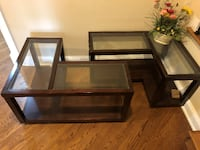 Two brown wooden framed glass top tables Hanover, 21076