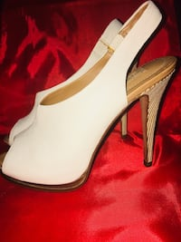 Pair of white leather peep-toe sling back stiletto heels Vancouver