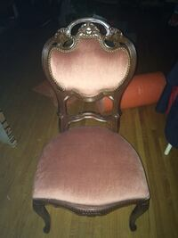 Brown wooden framed pink padded armchair 543 km