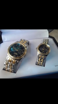 two round gold and silver colored chronograph watches