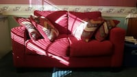 Red fabric loveseat and matching accent chair