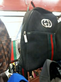 black and red leather backpack