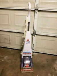 white and gray Bissel Lightest vacuum cleaner Houston, 77063