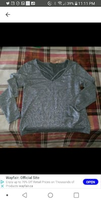 New Shiny silver top M/L Laval, H7M 4A2