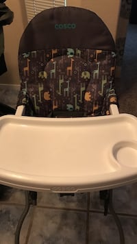 toddler's black and multicolored Cosco high chair with white activity tray
