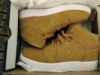 pair of brown suede work boots in box