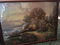 "Thomas Kincaid professionally framed puzzle.     It measures 28"" across x 21"" tall"