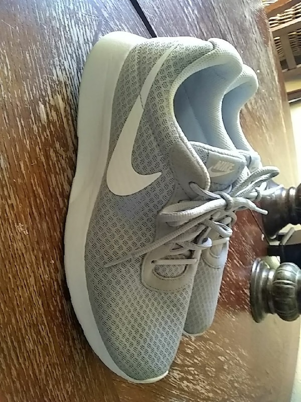 gray-and-white Nike lace-up running shoes