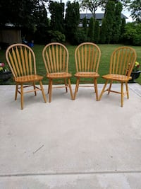 four brown wooden windsor chairs Maple Ridge, V2X 5J6