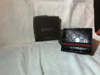 black Gucci leather monogrammed wallet