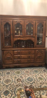 brown wooden framed glass display cabinet Montréal, H4A 1Y3
