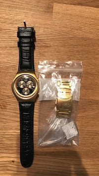 SWATCH WATCH with leather strap and gold coloured links  Toronto, M6J 3K6