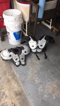 white and black shoulder pads Houston, 77083