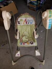 baby's green and white swing chair
