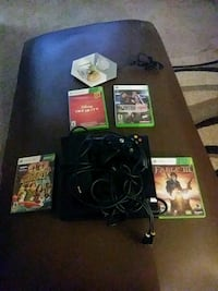 black Xbox One console with controller and game cases Decatur, 30033