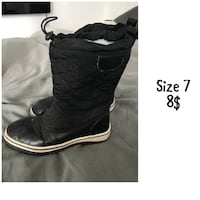 pair of black leather boots London, N5V 4S6