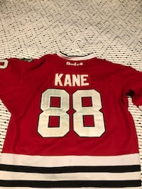Blackhawks Jersey with Stanley cup logo.