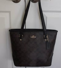 monogrammed black Coach leather tote bag