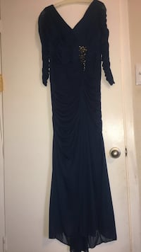 Navy blue long-sleeved formal gown