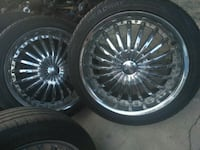 chrome multi-spoke car wheel with tire set Los Angeles, 90037