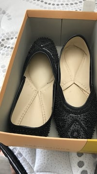 pair of black leather flats Surrey, V3W