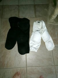 Two pairs of football leg pads Palm Bay, 32907