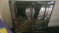 Mirror, iron and glass. Came from home interiors Glen Burnie, 21061