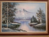brown wood-framed painting of Banff National Park