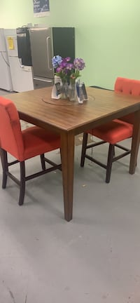 Floor model clearance sale solid wood Ashley table and two chairs Essex, 21221
