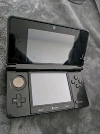 black Nintendo DS with charger