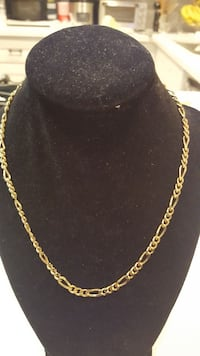 gold-colored figaro chain necklace