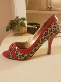 Leopard print stiletto shoes with red trim and hea