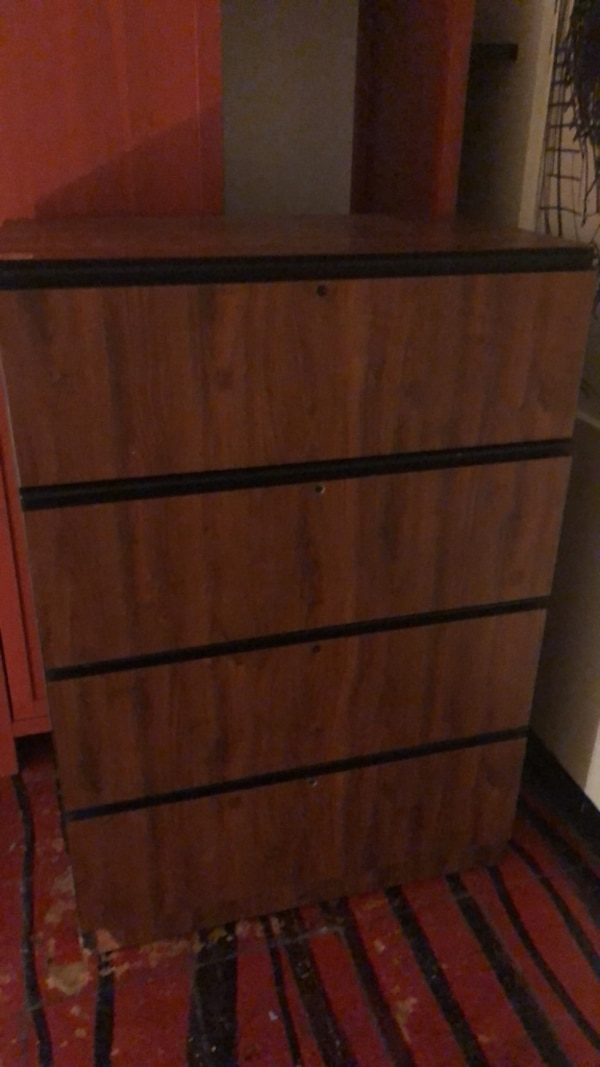 brown wooden 4-drawer chest