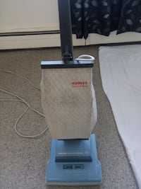 gray and white Hoover upright vacuum cleaner 2472 km