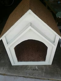 white and brown wooden pet house