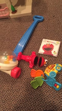 Baby lot. Fisher price piping toy. Elmo talking toy with batteries, new Elmo bath book and vtech baby keys with sounds and lights and include batteries. Only $10!!! Vaughan, L4J 5L7