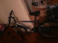black and blue hardtail mountain bike