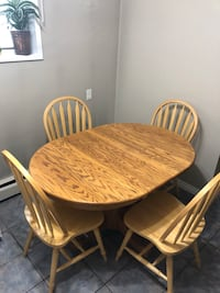 Oak wood table and 4 chairs. In decent shape. Need gone ASAP. {*OBO*} Edmonton, T5J