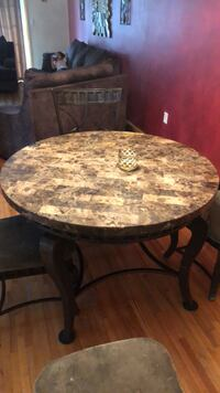round brown wooden table with chairs Elizabeth, 07201