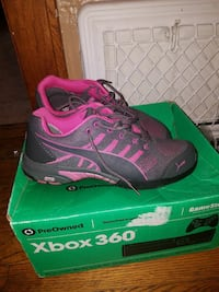 black-and-pink Puma running shoes