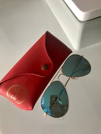 gold-colored framed Ray-Ban Aviator with red leather case